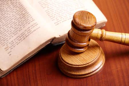 judge hammer: Old book and gavel on wooden desk