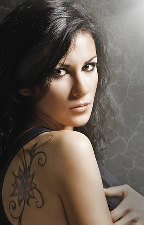 Beautiful woman with tatoo photo