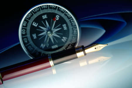 law office: Pen with golden nib with compass and papers in the background