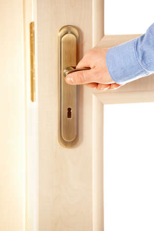 Male hand on handle, opening or closing door Stock Photo - 12962555