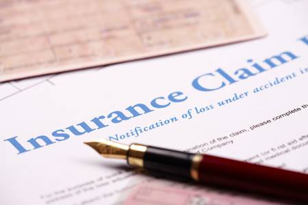 insurance policy: Blank insurance claim form and other papers like ID or vehicle documents and pen lying on desk Stock Photo