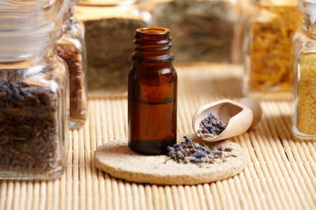 remedy: Dried caledula lavender petals with macerated oil on the stone mat Stock Photo