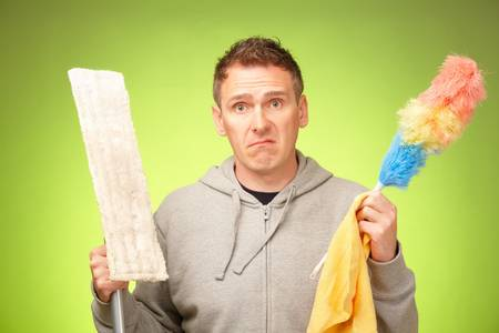Man unhappy, confused and unsure being not prepared to clean a house photo
