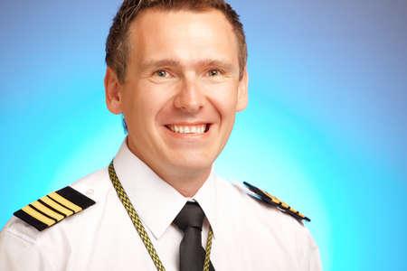 epaulettes: Airline pilot wearing uniform with epaulettes