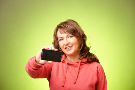 Young Pretty Woman showing her new smartphone  Focus on the face   photo