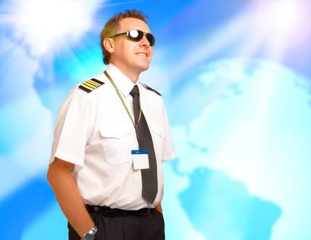 Airline pilot wearing uniform with epaulettes  photo