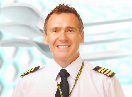 Airline pilot wearing uniform with epaulettes  photo