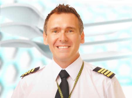 epaulets: Airline pilot wearing uniform with epaulettes