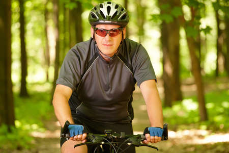 Man on bike riding in the forest  photo