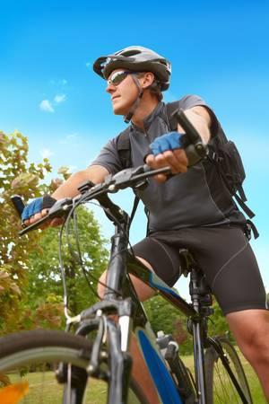 Man on bike riding, natural background  photo