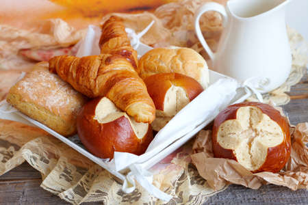 Various types of bread like French croissants, Italian ciabatta, German buns and other photo