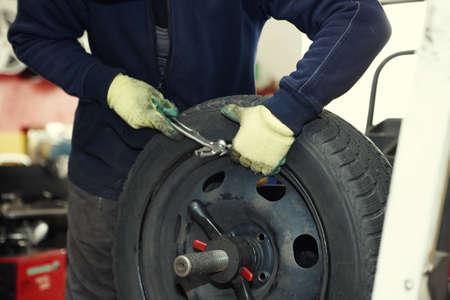 wheel balancing: Professional auto mechanic balancing wheel before change it Stock Photo