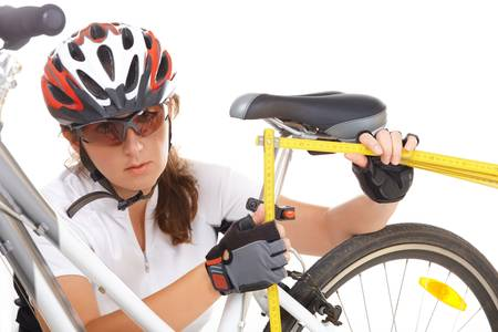 saddle: Measuring and making an adjustment in the bike saddle Stock Photo