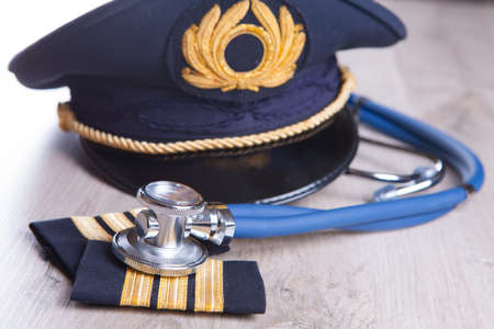 Close up of an airplane pilot equipment hat and epaluetes with doctor Stock Photo - 18145661
