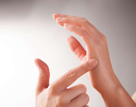 emotional freedom: Woman doing EFT on the karate chop point. Emotional Freedom Techniques, tapping, a form of counseling intervention that draws on various theories of alternative medicine.  Stock Photo