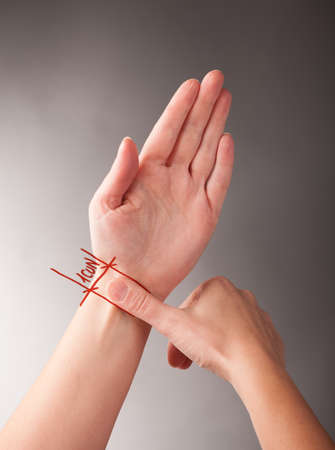 Acupressure, acupuncture  How to measure 1 CUN, a traditional Chinese unit of length  Its traditional measure is the width of a person photo