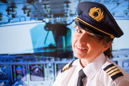 Beautiful woman pilot wearing uniform photo
