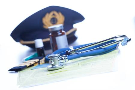 faa: Close up of an airplane pilot equipment hat and epaluetes with doctor