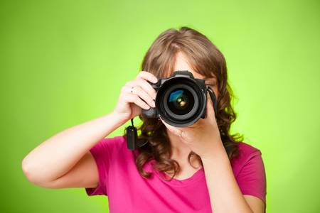 photographer: Female photographer taking photos with DSLR digital camera