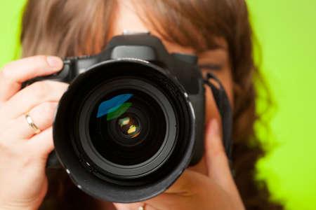 Female photographer taking photos with DSLR digital camera photo