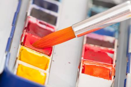 paint box: Professional watercolor paints with artistic brush Stock Photo