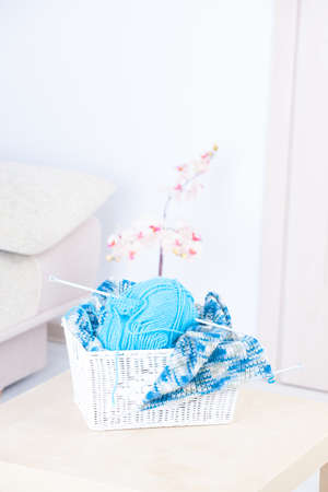 acrylic yarn: Basket with ball of knitting yarn and knitting needle