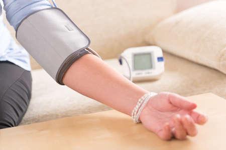 blood pressure cuff: Women Stock Photo