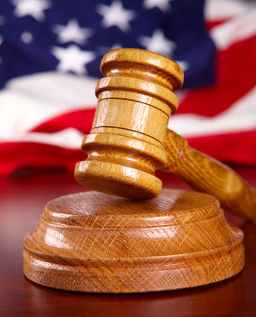 Judges wooden gavel with USA flag  photo