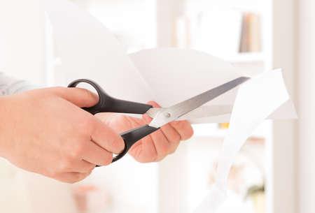 Woman cutting a paper photo