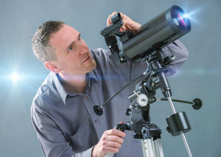eyepiece: Man looking skyward through astronomical telescope Stock Photo