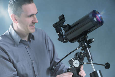 Man with astronomical telescope photo