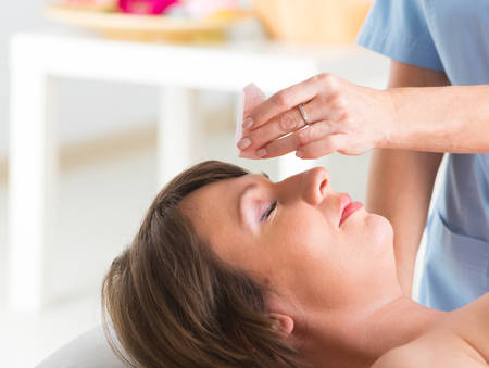 Alternative medicine, therapist using gemstones for lithotherapy Stock Photo