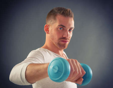 Happy attractive sporty handsome man doing workouts  photo