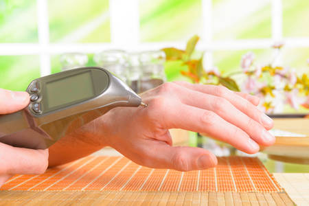 Finding an acupuncture point with electronic device which could be also used to apply electroacupuncture, PENS Stock Photo - 26982866