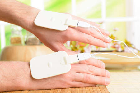 electrode: Electrotherapy, electrical stimulation using surface electrode pads with a conductor gel placed on the skin
