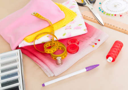 accesories: Colorful fabrics, threads, buttons, thimble and other sewing accesories