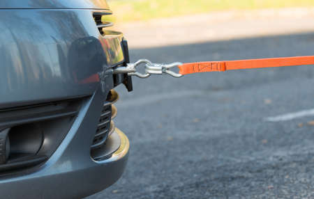 towing: Towing hook and tow rope assembled to a broken car