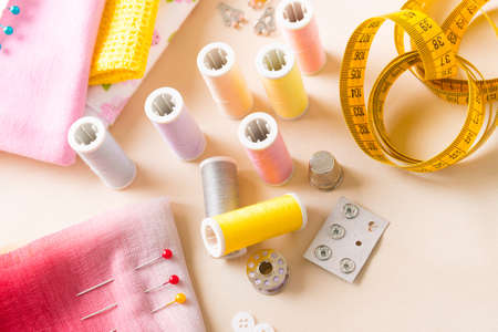 accesories: Reels of thread, buttons, thimble and other sewing accesories on the table Stock Photo