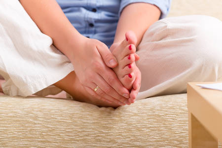 Woman practicing self Reiki transfering energy through palms, a kind of energy medicine  Stock Photo