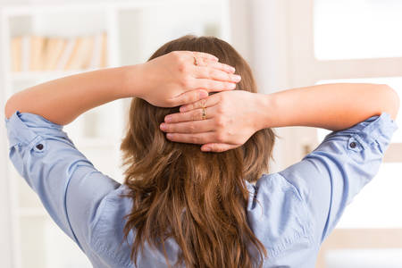 occiput: Woman practicing self Reiki transfering energy through palms, a kind of energy medicine  Stock Photo