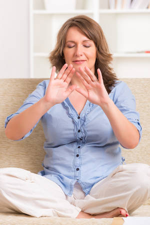 transfering: Woman practicing Reiki transfering energy through palms, a kind of energy medicine