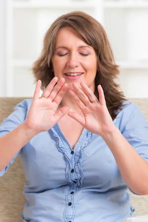 alternative healer: Woman practicing Reiki transfering energy through palms, a kind of energy medicine