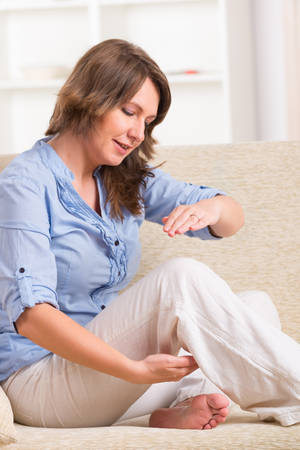 alternative practitioner: Woman practicing self Reiki transfering energy through palms, a kind of energy medicine  Stock Photo