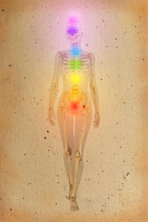 holistic health: Chakras illustrated over human body with visible skeleton on old parchment