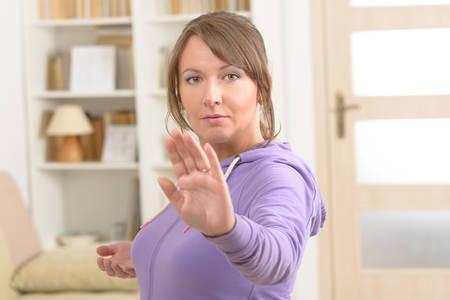 qigong: Beautiful woman doing qi gong tai chi exercise at home