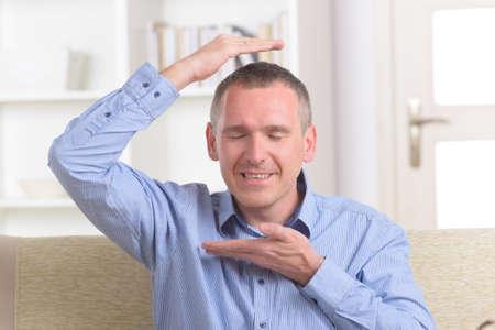 transfering: Man practicing self Reiki transfering energy through palms, a kind of energy medicine.