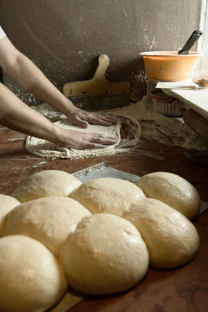 Fresh original Italian raw pizza, dough preparation in traditional style. photo