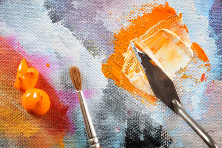 Professional acrylics paints with artistic putty knife and brush on canvas Stock Photo