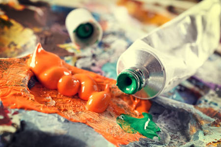 painter palette: Professional acrylics paints in tubes on a painter palette Stock Photo