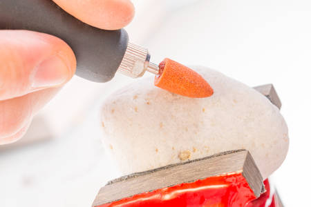 engraver: Using a high speed rotary multi tool to cutting and polishing on the stone